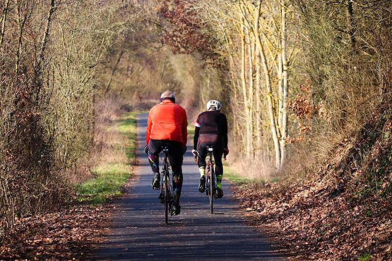 Two Cyclists in Autumn