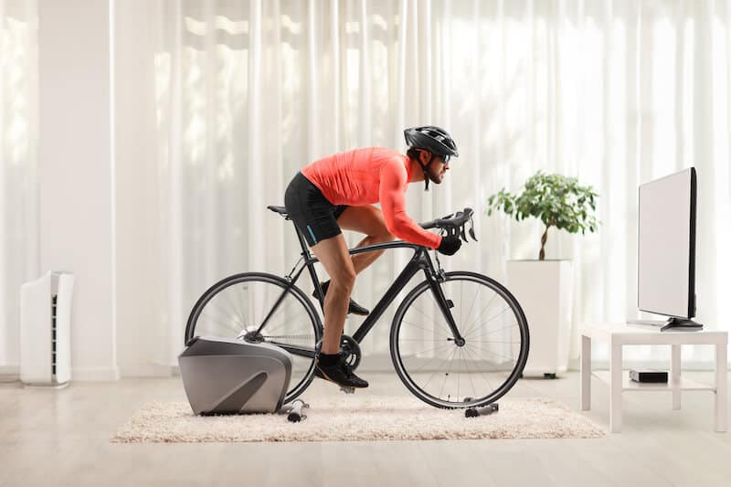 Man Cycling With Stationary Bike Trainer