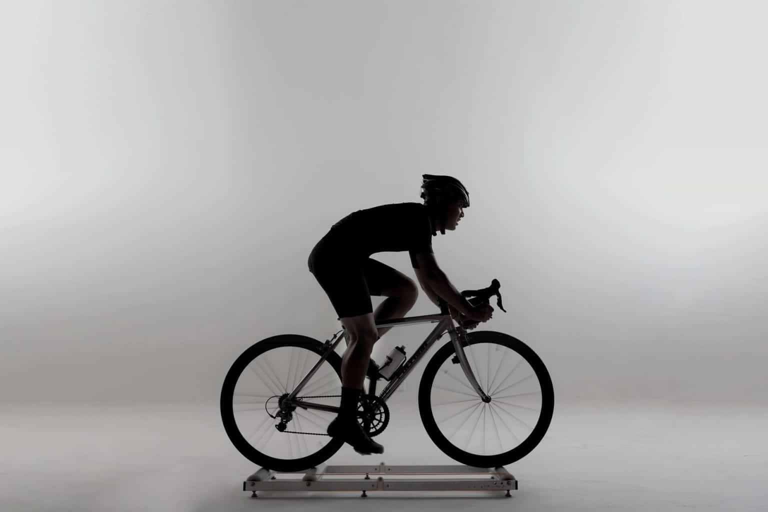 A man training indoors on a bike trainer