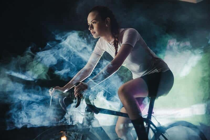 Female Bike Rider In Action Shot With Smoke
