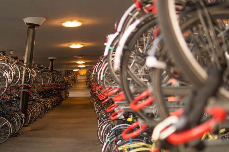 Lots of bikes hung up in a bike garage