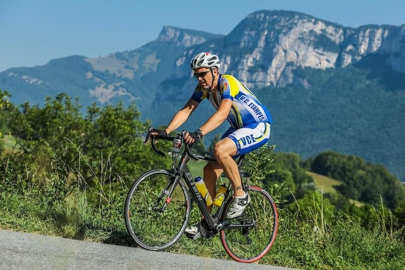 Man Cycling Up Hill on a road bike