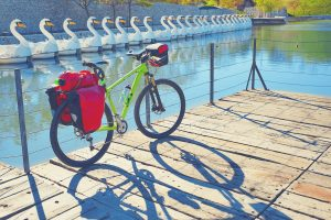 MTB Bicycle touring bike in a park with convertible pannier backpack