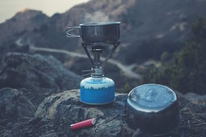 Bikepacking camp stove overlooking cliff
