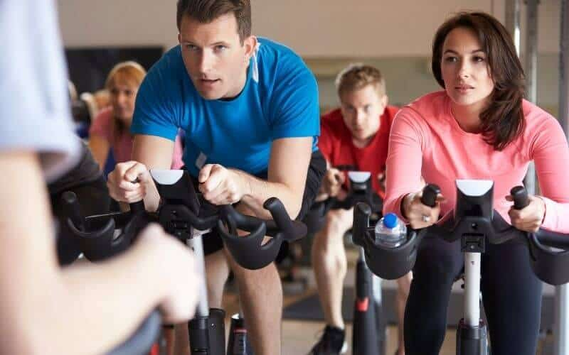Woman and Man in a spinning class