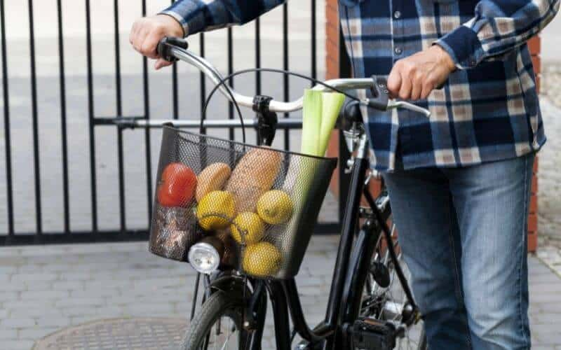 Cycling with groceries in front basket