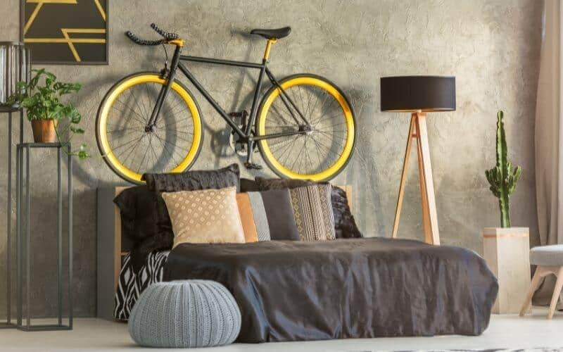 Bike mounted on a wall in the bedroom