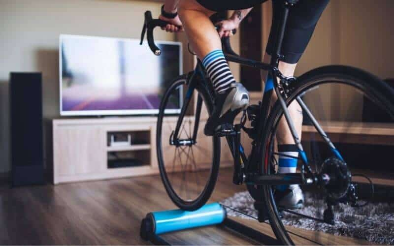 Cyclist on roller in front of TV