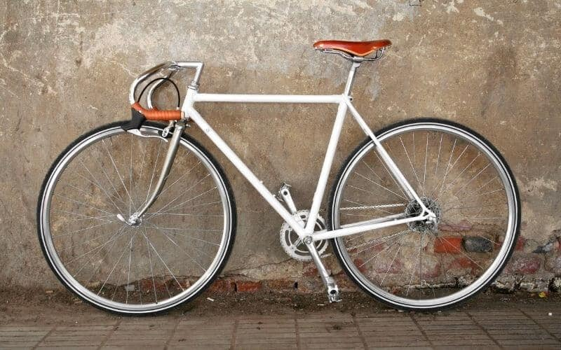 White fixie bike with leather drop handles