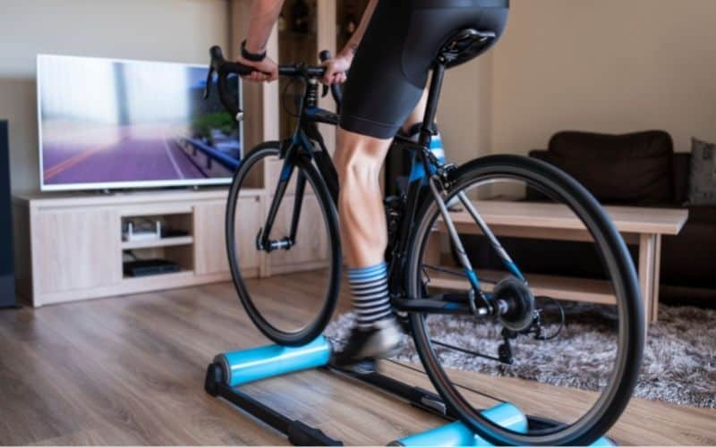 Indoor cyclist on a bike roller trainer