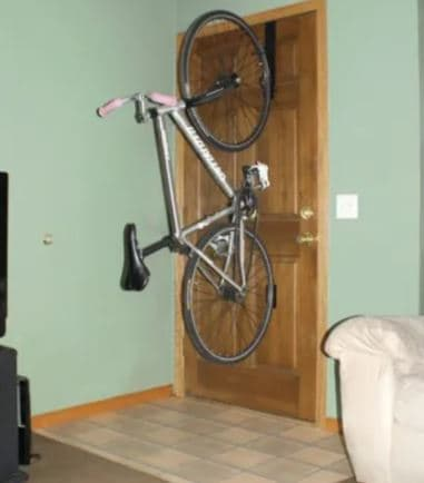 Bike loaded into a door mount system