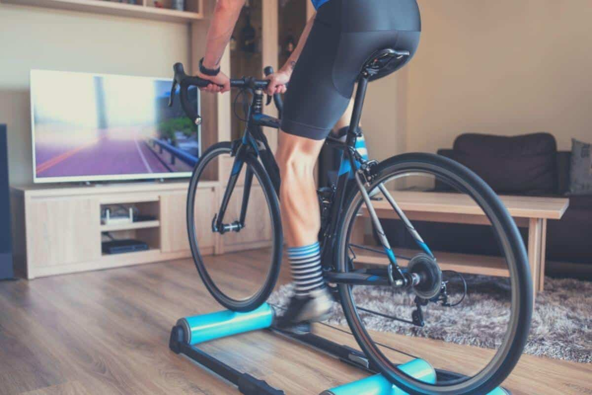 Man Indoor Cycling On A Blue Bike Roller