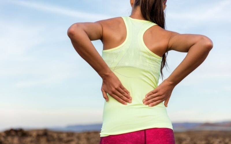 Fit woman with lower back pain