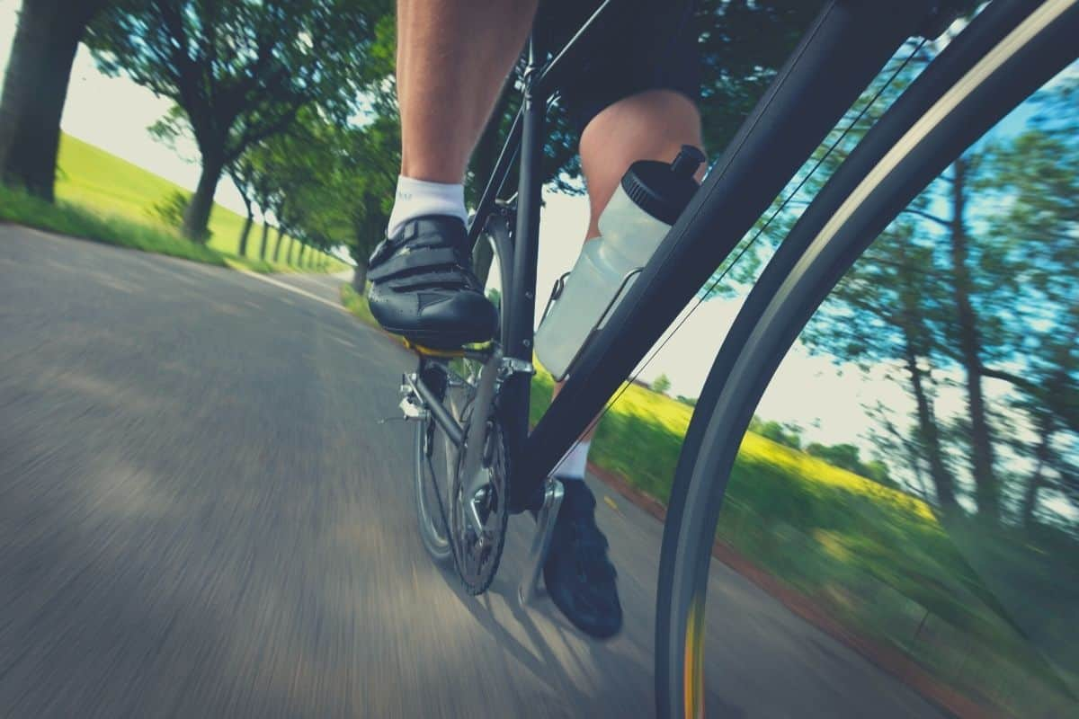 Cyclist with Black Road Bike Cycling Shoes